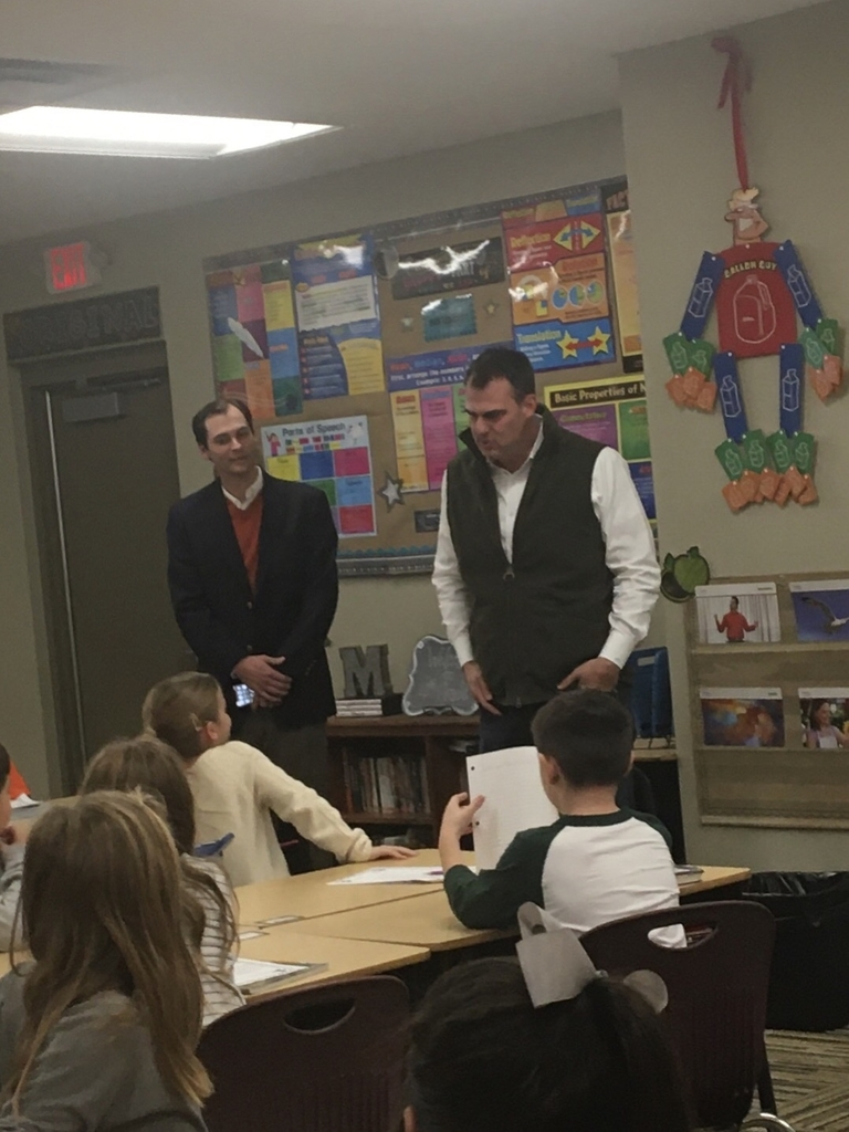 Governor Stitt visiting with fourth grade.